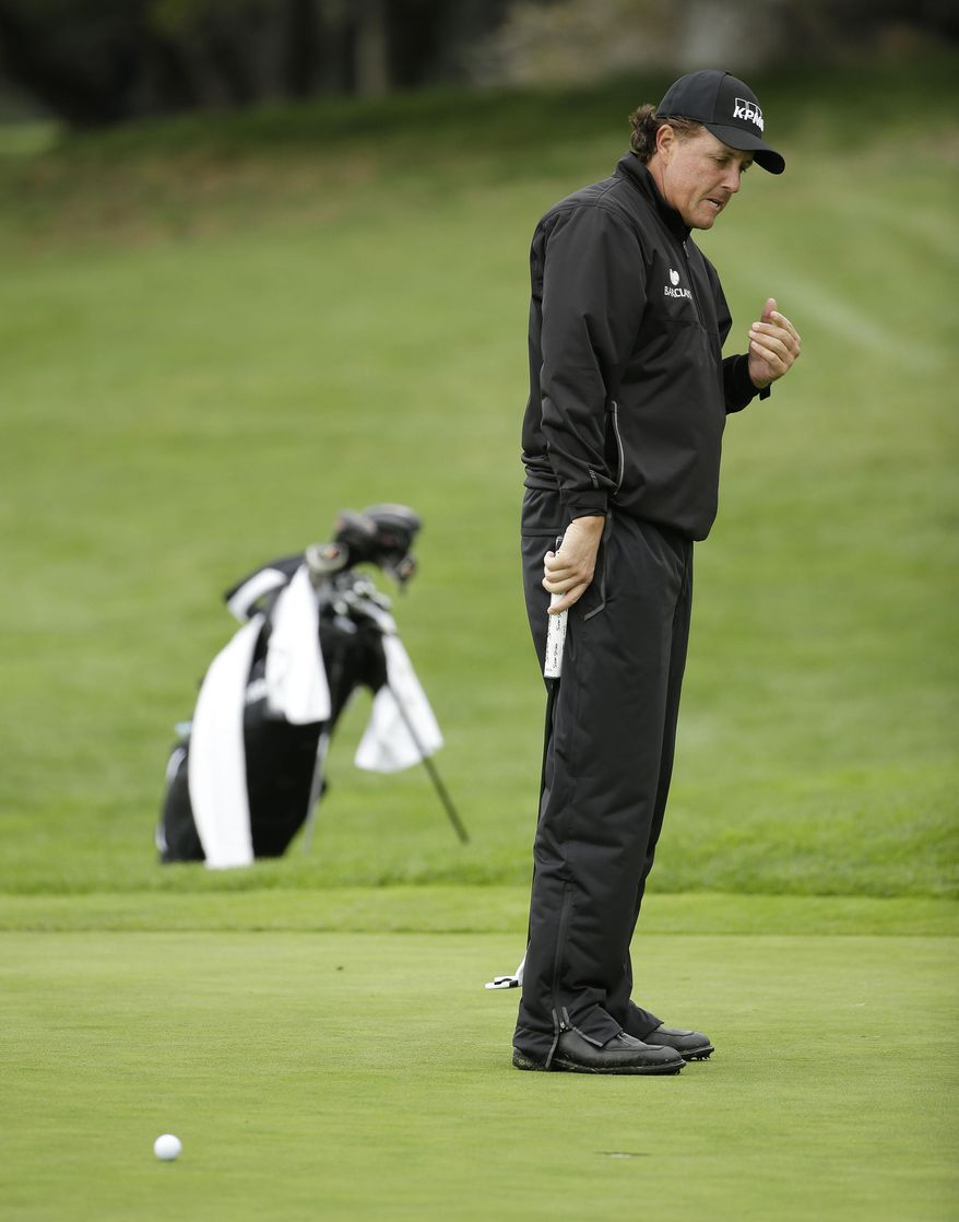 Phil Mickelson reacts after missing a birdie putt on the first green during the final round of the AT&T Pebble Beach Pro-Am golf tournament, Sunday, Feb. 9, 2014, in Pebble Beach, Calif. (AP Photo/Eric Risberg)