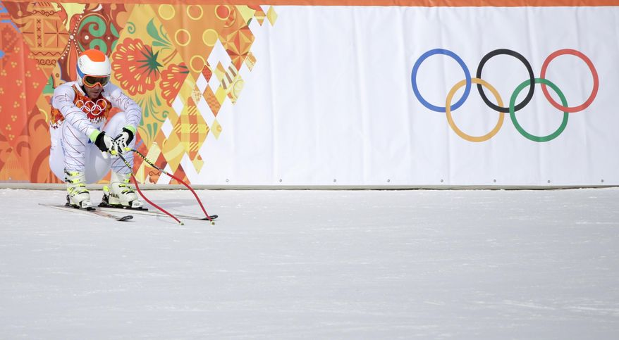 United States' Bode Miller reacts after finishing the men's downhill at the Sochi 2014 Winter Olympics, Sunday, Feb. 9, 2014, in Krasnaya Polyana, Russia. (AP Photo/Gero Breloer)