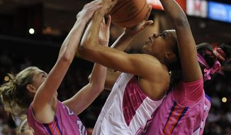 Maryland's Alicia DeVaughn, center, is sandwiched between Clemson's Jordan Gaillard, left, and Nyilah Jamison-Myers in the first half of an NCAA women's college basketball game, Sunday, Feb. 9, 2014, in College Park, Md. (AP Photo/Gail Burton)
