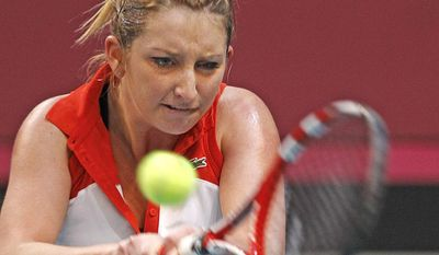 Switzerland's Timea Bacsinszky returns the ball to France's Alize Cornet, during their singles match, in the Fed Cup tournament between France and Switzerland, at the Coubertin stadium in Paris, Sunday Feb. 9, 2014. (AP Photo/Remy de la Mauviniere)