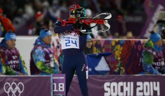 Norway's Ole Einar Bjoerndalen shoots during the men's biathlon 10k sprint, at the 2014 Winter Olympics, Saturday, Feb. 8, 2014, in Krasnaya Polyana, Russia. Norway's Ole Einar Bjoerndalen got the gold. (AP Photo/Gero Breloer)