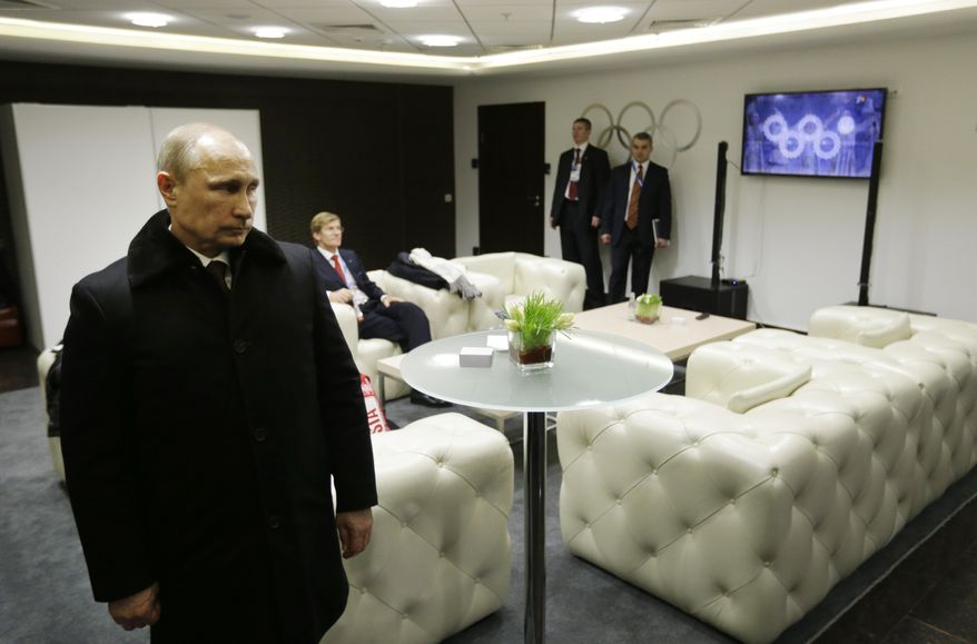 In this second in a sequence of four images, one second after the previous one, Russian President Vladimir Putin waits in the presidential lounge to be introduced at the opening ceremony of the 2014 Winter Olympics on Friday, Feb. 7, 2014, in Sochi, Russia. Behind him, a TV screen shows four of the Olympic rings almost fully open at the start of the ceremony, while the fifth ring remains closed. (AP Photo/David Goldman, Pool)