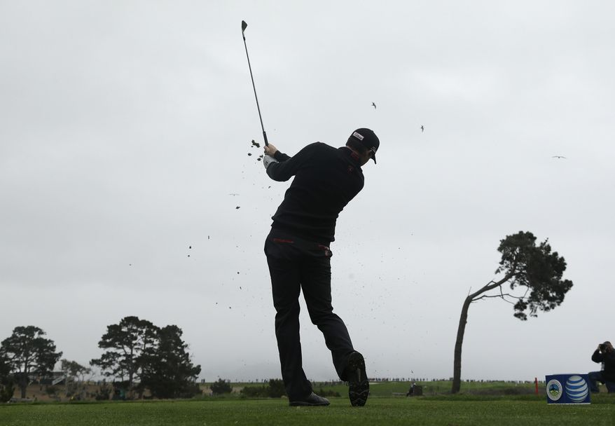 Jimmy Walker hits from the fifth tee during the final round of the AT&T Pebble Beach Pro-Am golf tournament, Sunday, Feb. 9, 2014, in Pebble Beach, Calif. (AP Photo/Eric Risberg)