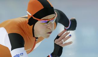 Ireen Wust of the Netherlands, her nails painted in the colors of the Dutch flag, competes in the women's 3,000-meter speedskating race at the Adler Arena Skating Center during the 2014 Winter Olympics, Sunday, Feb. 9, 2014, in Sochi, Russia. (AP Photo/Matt Dunham)