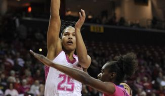 Maryland's Alyssa Thomas (25) shoots over Clemson's Nikki Dixon in the first half of an NCAA women's college basketball game, Sunday, Feb. 9, 2014, in College Park, Md. (AP Photo/Gail Burton)