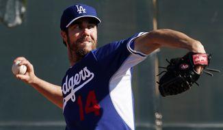 Los Angeles Dodgers' Dan Haren pitches during spring training baseball practice Sunday, Feb. 9, 2014, in Glendale, Ariz. (AP Photo/Paul Sancya)
