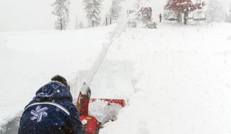 In this Feb. 9, 2014, photo provided by Northstar California Resort, crews work to clear paths on the ski slopes north of Lake Tahoe in Truckee, Calif. Sierra ski resorts and drought-stricken farmers are rejoicing after a weekend storm dumped up to 5 feet of snow on top of the mountains and brought near-record rainfall to Lake Tahoe. (AP Photo/Northstar California Resort).