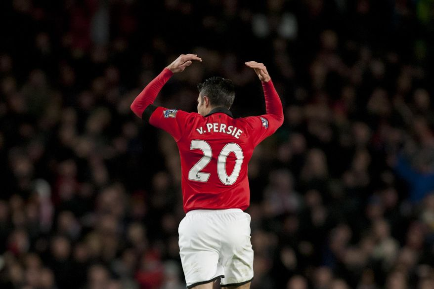 Manchester United's Robin van Persie celebrates after scoring against Fulham during their English Premier League soccer match at Old Trafford Stadium, Manchester, England, Sunday Feb. 9, 2014. (AP Photo/Jon Super)