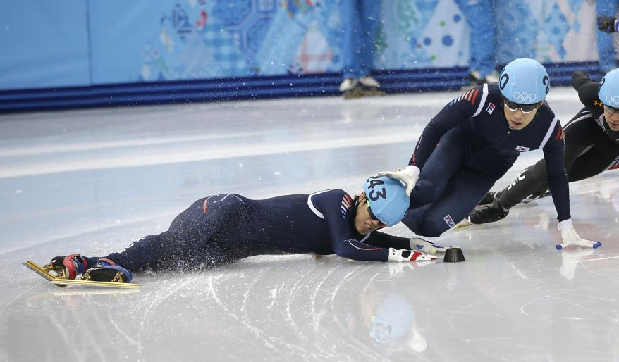 Sin Da-woon of South Korea, left, crashes as Lee Han-bin of South Korea goes down with him in a men's 1500m short track speedskating semifinal at the Iceberg Skating Palace during the 2014 Winter Olympics, Monday, Feb. 10, 2014, in Sochi, Russia. (AP Photo/Darron Cummings)