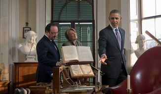 President Barack Obama, right, and French President Francois Hollande, left, view Thomas Jefferson's office at during a tour of Monticello, Monday, Feb. 10, 2014, in Charlottesville, Va. Leading the tour is Leslie Bowman, center, president of the Thomas Jefferson Foundation. (AP Photo/Pablo Martinez Monsivais)