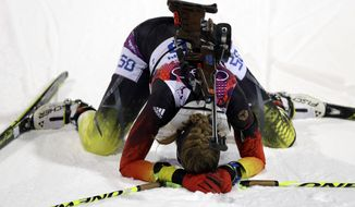 Germany's Franziska Preuss kneels on the snow after completing the women's biathlon 7.5k sprint, at the 2014 Winter Olympics, Sunday, Feb. 9, 2014, in Krasnaya Polyana, Russia. (AP Photo/Kirsty Wigglesworth)