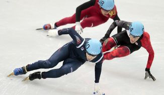 Lee Han-bin of South Korea leads ahead of Michael Gilday of Canada, right, and Dequan Chen of China, back, in a men's 1500m short track speedskating heat at the Iceberg Skating Palace during the 2014 Winter Olympics, Monday, Feb. 10, 2014, in Sochi, Russia. (AP Photo/Ivan Sekretarev)
