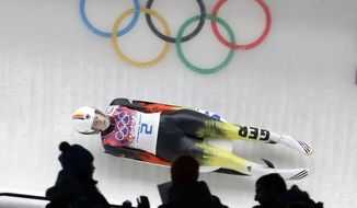 Natalie Geisenberger of Germany speeds down the track in her second run during the women's singles luge competition at the 2014 Winter Olympics, Monday, Feb. 10, 2014, in Krasnaya Polyana, Russia. (AP Photo/Natacha Pisarenko)