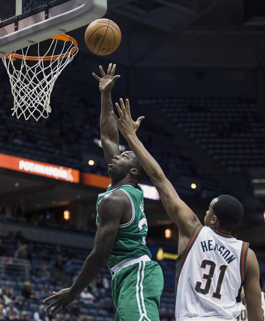 Milwaukee Bucks' John Henson tries to stop Boston Celtics' Brandon Bass, left, during the first half of an NBA basketball game, Monday, Feb. 10, 2014, in Milwaukee. (AP Photo/Tom Lynn)