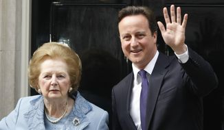 """FILE- In this June, 8, 2010 file photo, Britain's Prime Minister David Cameron, right, poses with former Prime Minister Margaret Thatcher on the doorstep of 10 Downing Street in London. For the past three decades, many Britons had hoped the rigid class system that defined their country from Dickens to """"Downton Abbey"""" was finally dying. Now they fear that class, their old bugbear, is back on the rise. (AP Photo/Alastair Grant, File)"""