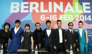 From left, screenwriter Ma Yingli, actors Qin Hao, Zhang Lei, director Lou Ye, actors Guo Xiadong, Huang Xuan, Mu Huaipeng and Lu Huang pose for photographers at the press conference for the film Blind Massage during the International Film Festival Berlinale in Berlin, Monday, Feb. 10, 2014. (AP Photo/Axel Schmidt)