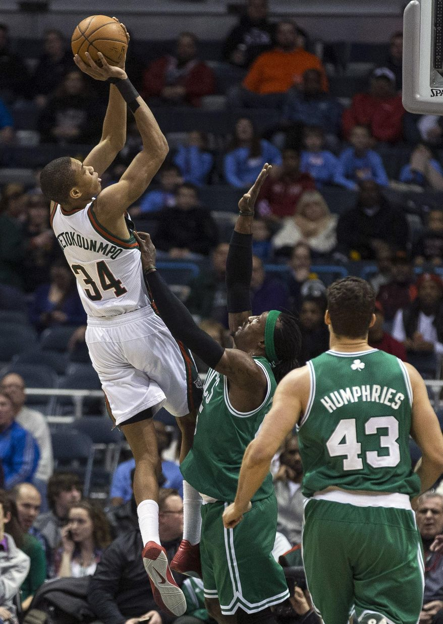 Milwaukee Bucks' Giannis Antetokounmp, left, shoots over Boston Celtics' Gerald Wallace during the first half of an NBA basketball game, Monday, Feb. 10, 2014, in Milwaukee. (AP Photo/Tom Lynn)