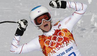 United States' Julia Mancuso celebrates after finishing the downhill portion of the women's supercombined at the Sochi 2014 Winter Olympics, Monday, Feb. 10, 2014, in Krasnaya Polyana, Russia.(AP Photo/Christophe Ena)