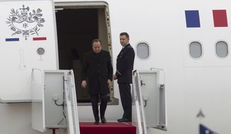 French President Francois Hollande steps out his plane upon arrival at Andrews Air Force Base, Md., Monday Feb. 10,  2014, for a three-day visit to U.S., including a state dinner hosted by Presidetn Barack Obama.  (AP Photo/Jose Luis Magana)