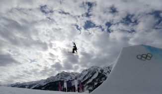 A competitor takes a jump during freestyle skiing slopestyle training at the 2014 Winter Olympics, Monday, Feb. 10, 2014, in Krasnaya Polyana, Russia. (AP Photo/Sergei Grits)