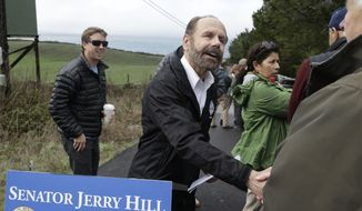 Democratic state Sen. Jerry Hill of San Mateo, shakes hands with a supporter after speaking about a beach access bill he introduced near Martin's Beach Monday, Feb. 10, 2014, in Half Moon Bay, Calif. A bill seeking to re-establish public access to a popular Northern California beach that was closed off after a Silicon Valley billionaire bought the adjacent land was introduced on Monday.  Hill said his bill would require the State Lands Commission to negotiate with Sun Microsystems Inc. co-founder Vinod Khosla to purchase some or all of his land at Martin's Beach. (AP Photo/Eric Risberg)