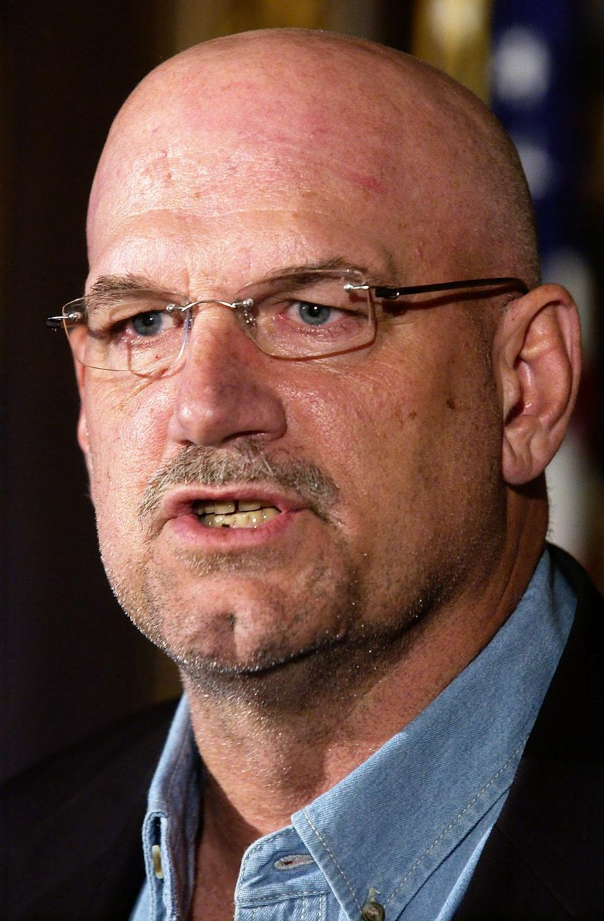 "FILE - In this Dec. 8, 2002 file photo, then Minnesota Gov. Jesse Ventura speaks during a news conference in St. Paul, Minn. Ventura contends he isn't going after the widow of slain ""American Sniper"" author Chris Kyle by continuing his defamation lawsuit. Ventura told The Associated Press late Monday, Feb. 10, 2014, his fight is with the publisher's insurance company. (AP Photo/Tom Olmscheid,File)"
