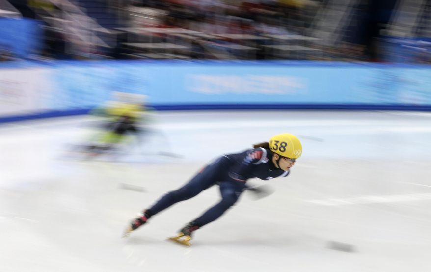 Park Seung-hi of South Korea competes in a women's 500m short track speedskating heat at the Iceberg Skating Palace during the 2014 Winter Olympics, Monday, Feb. 10, 2014, in Sochi, Russia. (AP Photo/Darron Cummings)