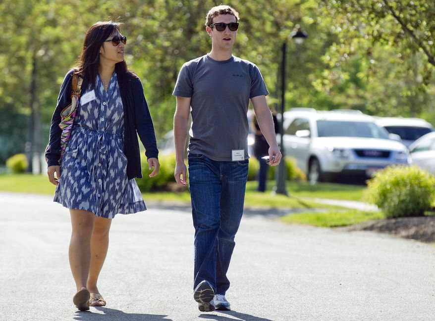 FILE- In this July 9, 2011 file photo, Mark Zuckerberg, president and CEO of Facebook, walks with Priscilla Chan during the 2011 Allen and Co. Sun Valley Conference, in Sun Valley, Idaho. Zuckerberg and his wife Chan were the most generous American philanthropists in 2013, with a donation of 18 million Facebook shares, valued at more than $970 million, given to a Silicon Valley nonprofit in December. (AP Photo/Julie Jacobson, File)