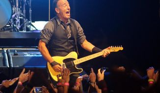 FILE - In this Sunday, Jan. 26, 2014, file photo, American performer Bruce Springsteen sings during his live performance in Cape Town, South Africa. Springsteen announced a new set of U.S. tour dates Monday, Feb. 10, 2014, after finishing recent treks in South Africa, Australia and New Zealand. Springsteen and the E Street Band will kick off the 15-date tour April 8 in Cincinnati. His new tour will visit Nashville, Tenn., Atlanta, Tampa, Fla., and Houston, among other cities. (AP Photo/Schalk van Zuydam, File)