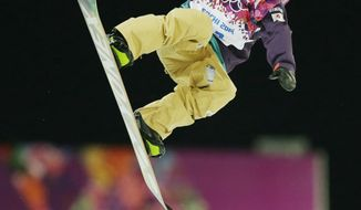 Japan's Ayumu Nedefuji gets air during a snowboard half pipe training session at the Rosa Khutor Extreme Park at the 2014 Winter Olympics, Monday, Feb. 10, 2014, in Krasnaya Polyana, Russia.  (AP Photo/Andy Wong)