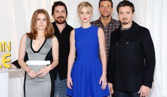 "FILE - In this Dec. 8, 2013 file photo, the cast of ""American Hustle,"" from left, Amy Adams, Christian Bale, Jennifer Lawrence, Bradley Cooper and Jeremy Renner pose together during a photo call at the Crosby Street Hotel, in New York. The film is nominated for ten Academy Awards. Oscar nominees will be honored at the Academy of Motion Picture Arts and Sciences annual Nominees Luncheon on Monday, Feb. 10, 2014, in Los Angeles. (Photo by Evan Agostini/Invision/AP, File)"