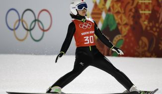 Japan's Sara Takanashi slows down in the finish area after an attempt during a women's normal hill ski jumping training at the 2014 Winter Olympics, Monday, Feb. 10, 2014, in Krasnaya Polyana, Russia. (AP Photo/Gregorio Borgia)