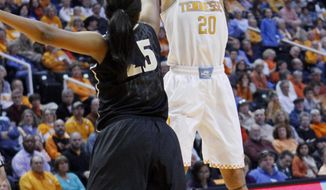 Tennessee center Isabelle Harrison (20) shoots over Vanderbilt guard Morgan Batey in the first half of an NCAA college basketball game, Monday, Feb. 10, 2014, in Knoxville, Tenn. (AP Photo/Wade Payne)