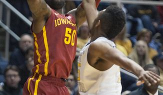 Iowa State's DeAndre Kane, left, looks to shoot over West Virginia's Terry Henderson during the first half of an NCAA college basketball game, Monday, Feb. 10, 2014, in Morgantown, W.Va. (AP Photo/Andrew Ferguson)