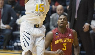 West Virginia's Terry Henderson (15) dunks during the first half of an NCAA college basketball game against Iowa State, Monday, Feb. 10, 2014, in Morgantown, W.Va. (AP Photo/Andrew Ferguson)