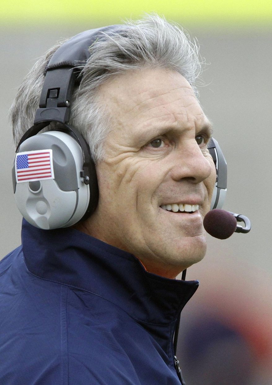FILE - In this Nov. 12, 2011, file photo, Illinois head coach Ron Zook looks on from the sidelines during the first half of the NCAA college football game against Michigan in Champaign, Ill. The Green Bay Packers formally introduce the new additions to the coaching staff, Monday, Feb. 10, 2014, including former Illinois and Florida head coach Ron Zook. (AP Photo/Seth Perlman, File)