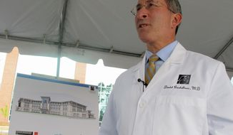 Dr. David Castellone, the president of Palmetto Primary Care Physicians, discusses plans for a new $135 million health care complex in the Nexton development in Summerville, S.C., on Monday, Feb. 10, 2014. The health complex is expected to create about 1,100 new jobs in the fast-growing suburb of Charleston, S.C. (AP Photo/Bruce Smith)