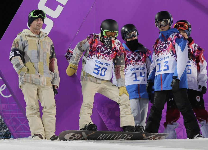 Shaun White of the United States, center, prepares for a run during a snowboard half pipe training session at the Rosa Khutor Extreme Park at the 2014 Winter Olympics, Monday, Feb. 10, 2014, in Krasnaya Polyana, Russia.  (AP Photo/Andy Wong)
