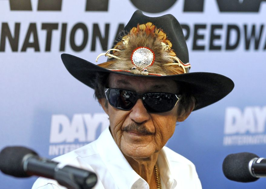 """FILE - In this Feb. 21, 2013 file photo, NASCAR Hall of Fame driver Richard Petty speaks during a news conference at Daytona International Speedway in Daytona Beach, Fla. Petty says Danica Patrick can only win a Sprint Cup Series race """"if everybody else stayed home.""""  The seven-time champion made the comment during a Sunday, Feb. 9, 2014, appearance at the Canadian Motorsports Expo in Toronto, according to the website wheels.ca. (AP Photo/Terry Renna, File)"""