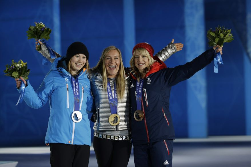 Women's snowboard slopestyle medalists from left, Enni Rukajarvi of Finland, silver, Jamie Anderson of the United States, gold, and Britain's Jenny Jones, bronze, pose during their medals ceremony at the 2014 Winter Olympics, Sunday, Feb. 9, 2014, in Sochi, Russia. (AP Photo/Morry Gash)