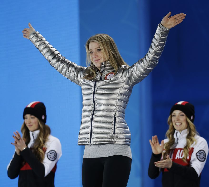 Women's moguls freestyle skiing bronze medalist Hannah Kearney of the United States gestures during the medals ceremony at the 2014 Winter Olympics, Sunday, Feb. 9, 2014, in Sochi, Russia. (AP Photo/Morry Gash)