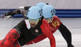 Charles Hamelin of Canada leads in a men's 1500m short track speedskating final at the Iceberg Skating Palace during the 2014 Winter Olympics, Monday, Feb. 10, 2014, in Sochi, Russia. (AP Photo/Bernat Armangue)