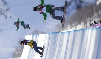 Athletes jump during a training session for the snowboard halfpipe competition at the 2014 Winter Olympics, Saturday, Feb. 8, 2014, in Krasnaya Polyana, Russia. (AP Photo/Jae C. Hong)