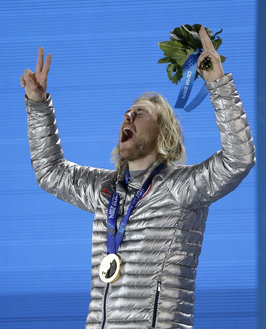 Gold medal winner Sage Kotsenburg, of the United States, reacts after receiving his medal during the medal ceremony for the Snowboard Men's Slopestyle competition at the 2014 Winter Olympics, Saturday, Feb. 8, 2014, in Sochi, Russia. (AP Photo/David J. Phillip )