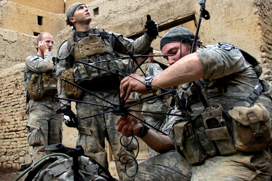 U.S. Soldiers with 2nd Platoon, Attack Company, 1st Regiment, 503rd Infantry Battalion, 173rd Airborne Brigade Combat Team set up a tactical satellite communication system in Shekhabad Valley, Wardak province, Afghanistan, Aug. 9, 2010. Photo by Sgt. Russell Gilchrest