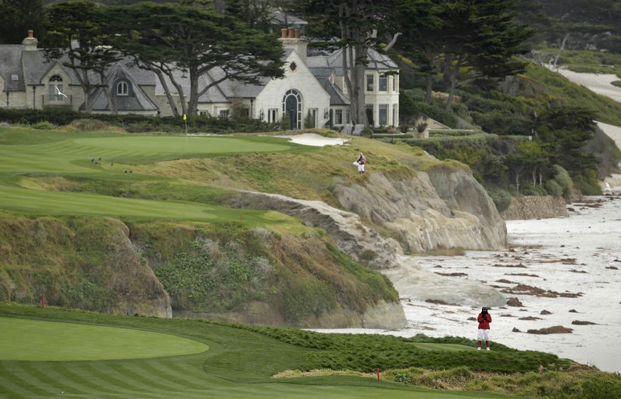 In this photo taken Friday, Feb. 7, 2014, a marshal at lower right stands on an optional 10th tee of the Pebble Beach Golf Links with the 10th green in the background during the second round of the AT&T Pebble Beach Pro-Am golf tournament in Pebble Beach, Calif. The optional 10th tee is to the right of the ninth green. Officials discovered it in old photos and restored it after they rebuilt the ninth green. Pebble Beach wants the USGA to look at it as a possible forward tee in the 2019 U.S. Open. (AP Photo/Eric Risberg)
