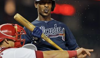 FILE - In this Aug. 6, 2013 file photo, Atlanta Braves' B.J. Upton reacts after a called third strike during the ninth inning of a baseball game against the Washington Nationals at Nationals Park in Washington. Spring training is Upton's chance for a fresh start after hitting .184 and losing his starting job in his Atlanta debut. (AP Photo/Alex Brandon, File)