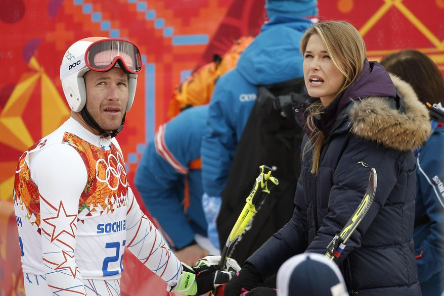 United States' Bode Miller talks with his wife Morgan near the finish area after completing Men's super combined downhill training at the Sochi 2014 Winter Olympics, Tuesday, Feb. 11, 2014, in Krasnaya Polyana, Russia. (AP Photo/Christophe Ena)
