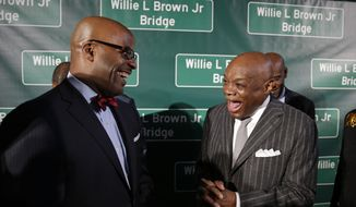 Former San Francisco Mayor and California State Assembly Speaker Willie Brown, right, laughs with state Assemblymember Isadore Hall of Los Angeles, left, before the dedication  of the Willie L. Brown, Jr. Bridge at Treasure Island Tuesday, Feb. 11, 2014, in San Francisco. Hall is the author of a bill which named the western span of the San Francisco-Oakland Bay Bridge for the former speaker and mayor. (AP Photo/Eric Risberg)