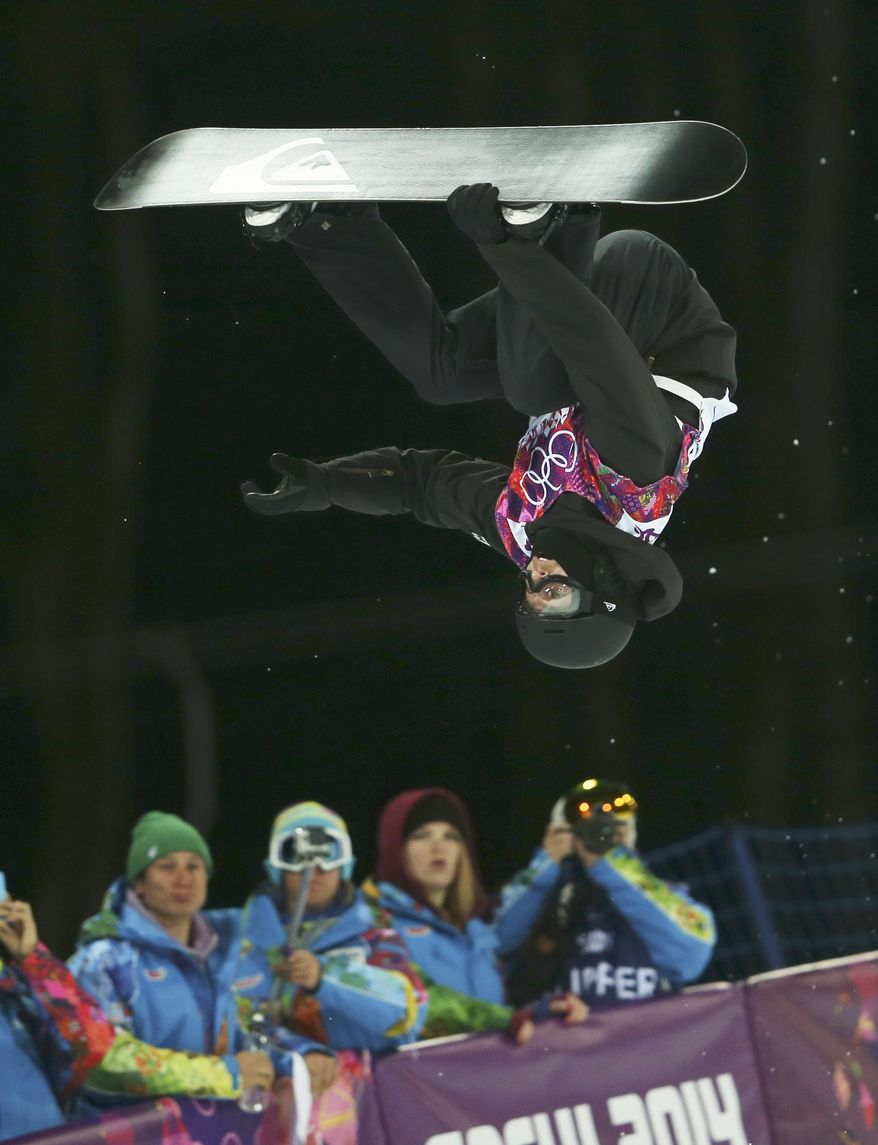 Switzerland's Iouri Podladtchikov competes in the men's snowboard halfpipe final at the Rosa Khutor Extreme Park, at the 2014 Winter Olympics, Tuesday, Feb. 11, 2014, in Krasnaya Polyana, Russia. Podladtchikov won the gold medal.  (AP Photo/Sergei Grits)